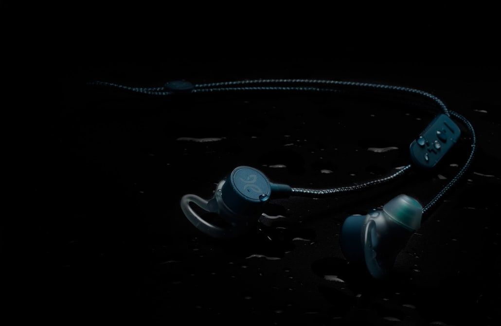 The Tarah Pro wireless earphones shown with water droplets for its IPX7 water resistant design