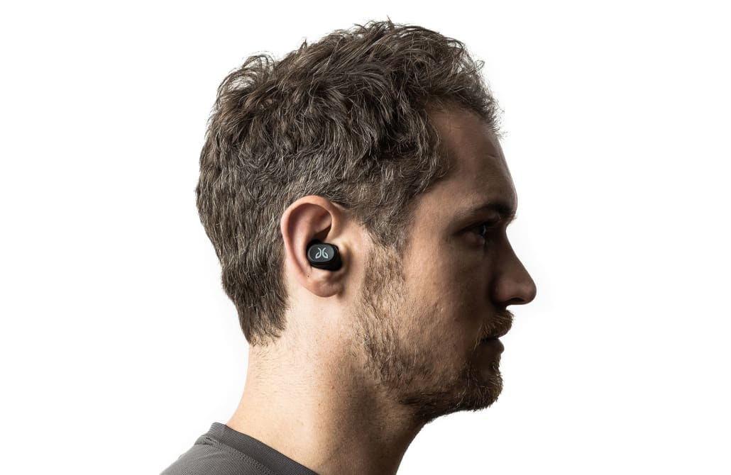 A person wearing ultra-comfortable Vista completely wireless sport earbuds